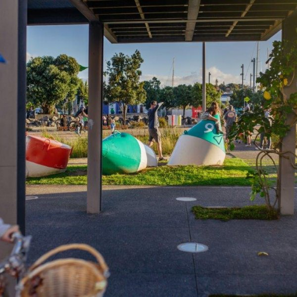 Cycling in Wynyard Quarter, view of Silo Park and art installations in the park
