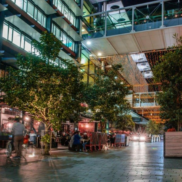 People enjoying an evening of food, drink and company under the fairy lights on Federal Street in Auckland's city centre. Image: Sacha Stejko.