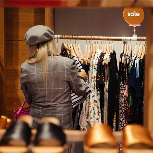 A woman browsing in a fashion store in Auckland's city centre. Image: Sacha Stejko.