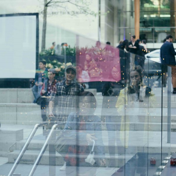 People gathered and talking outside Auckland Art Gallery in Auckland City Central during Art Week