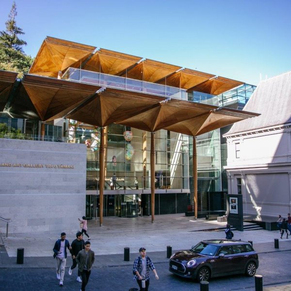 Auckland Art Gallery in the city centre with people and cars on Kitchener Street in foreground. Image: Sacha Stejko.