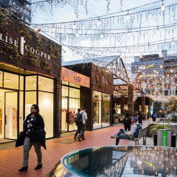 People shopping and spending time in Britomart in Auckland's city centre, with fairy lights, Trelise Cooper, Coop and Lineage. Image: Sacha Stejko.