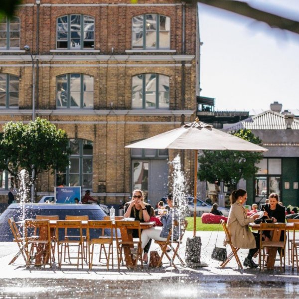 People enjoying lunch in Takutai Square, Britomart in Auckland's city centre. Image: Sacha Stejko.