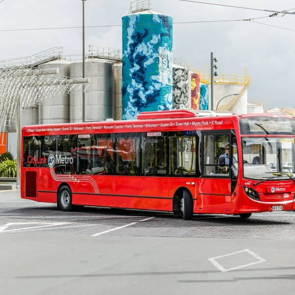 CityLink AT Metro bus moving through Wynyard Quarter and Silo Park with views of the silos and art