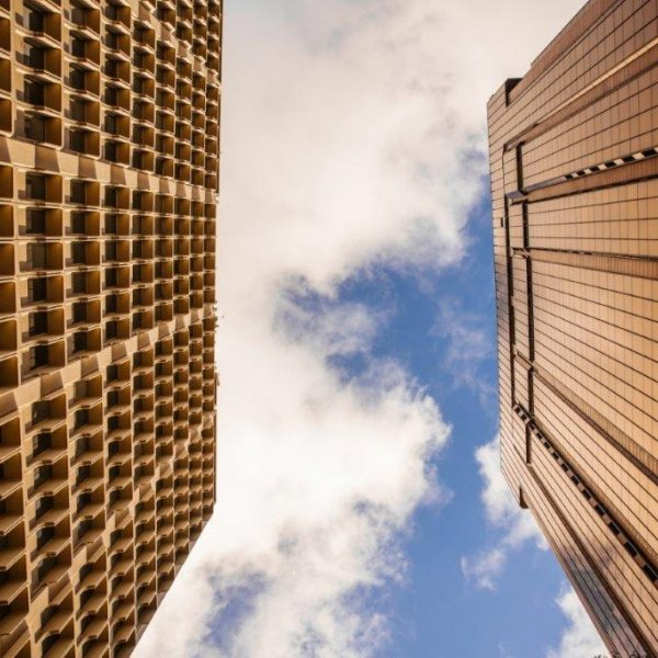 High rise buildings on Queen Street in Auckland's city centre - Acrossia House and the SAP Building at the corner of Wyndham Street. Image: Sacha Stejko.