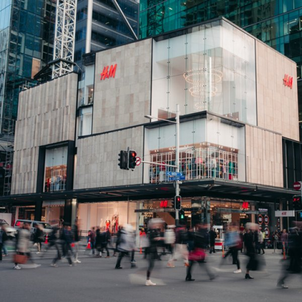 People crossing Queen Street outside H&M Commercial Bay on opening day. Image: Logan West