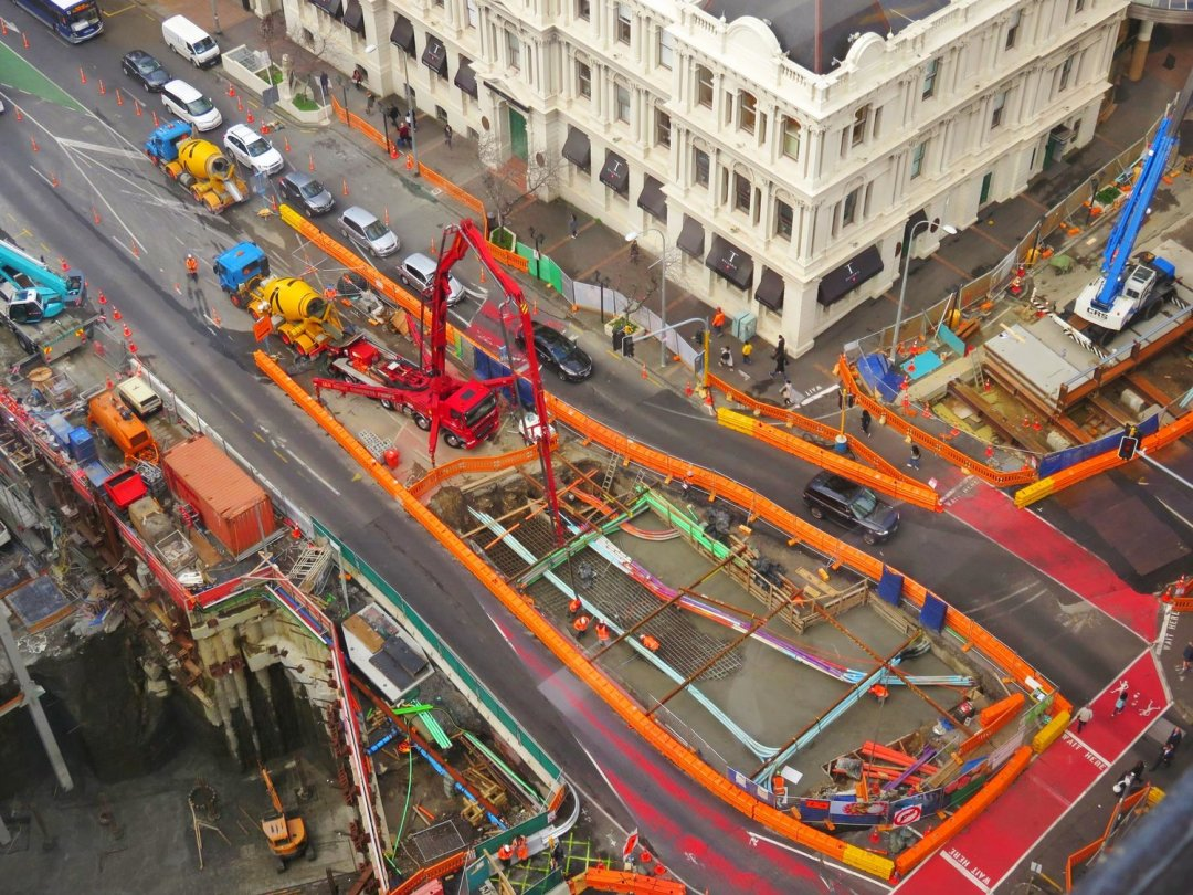 Birds eye view of CRL construction being done on Albert Street in Auckland City Centre around heritage buildings such as DFS Galleria, pedestrians and traffic