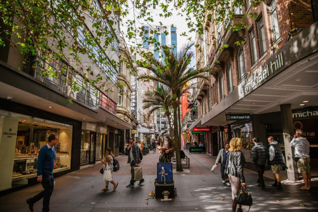 People walking across the intersection of Queen Street and Vulcan Lane in Auckland's city centre. Image: Sacha Stejko